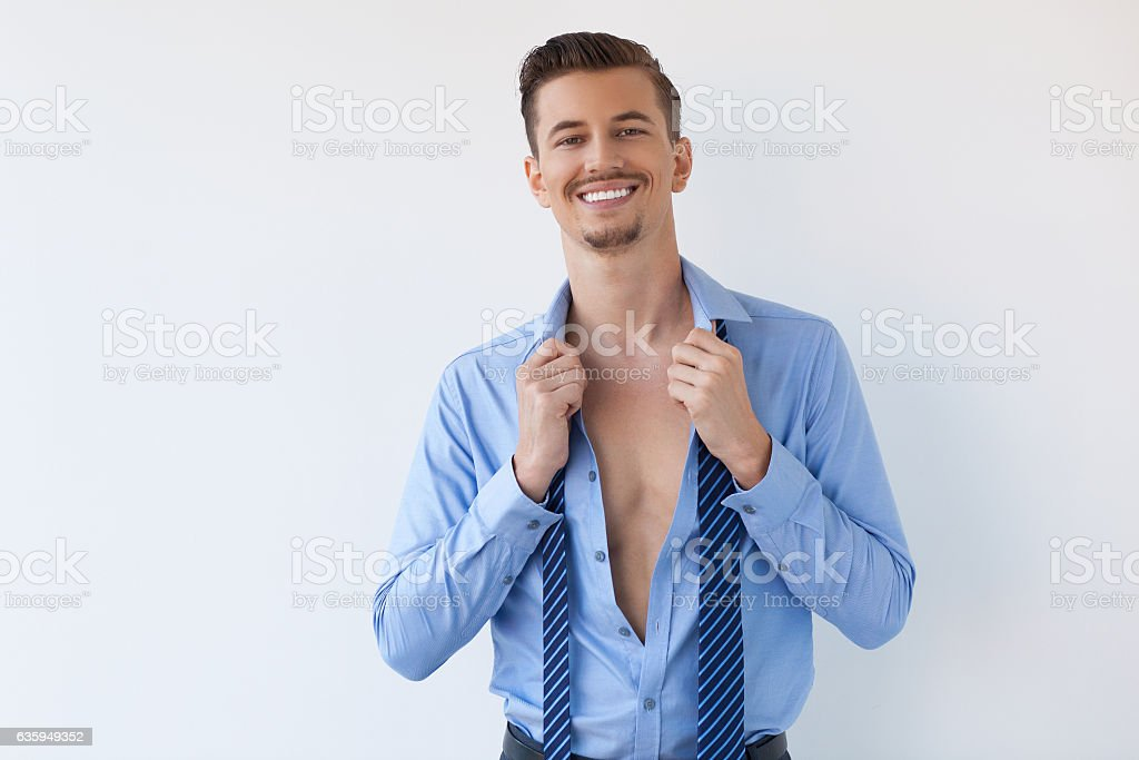 Smiling Young Handsome Business Man Undressing stock photo