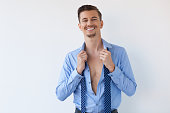 Smiling Young Handsome Business Man Undressing