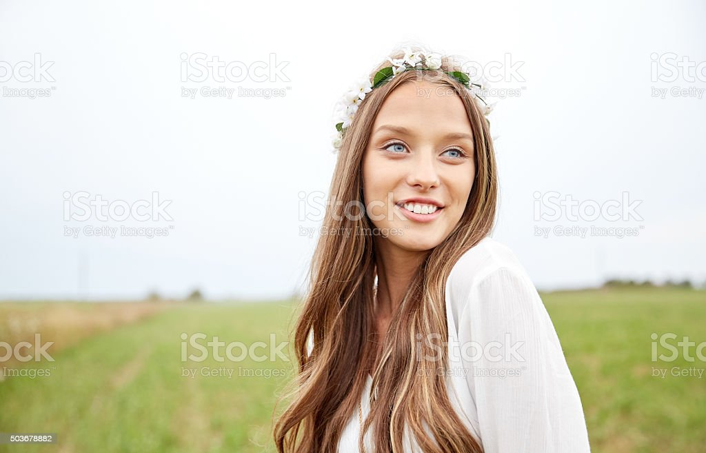 smiling young hippie woman on cereal field stock photo