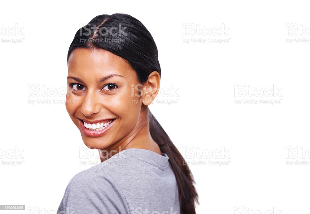 Smiling young lady looking back over shoulder isolated on white stock photo