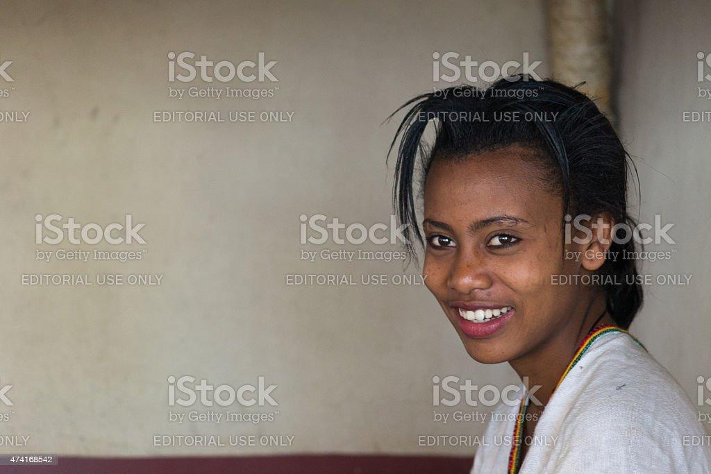 Smiling young lady of ethiopian ethnicity stock photo