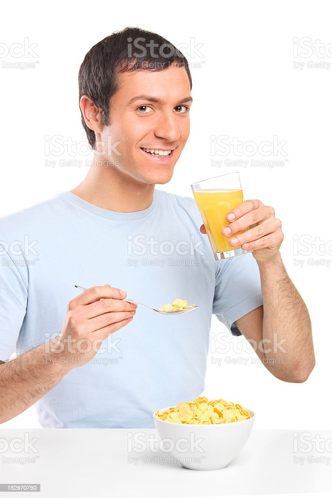 Smiling young male at breakfast royalty-free stock photo
