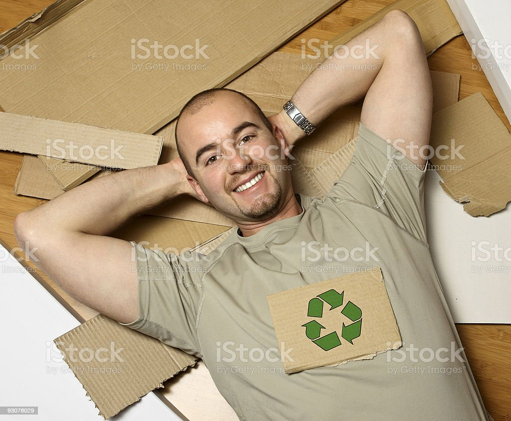 smiling young man and recycle symbol on cardboard royalty-free stock photo