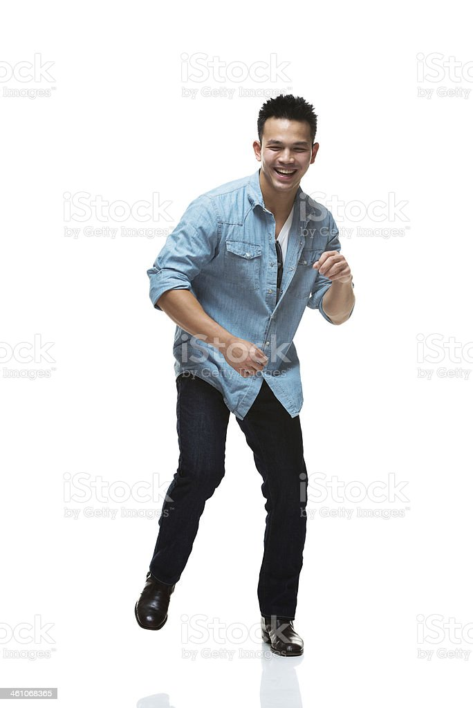 Smiling young man dancing royalty-free stock photo