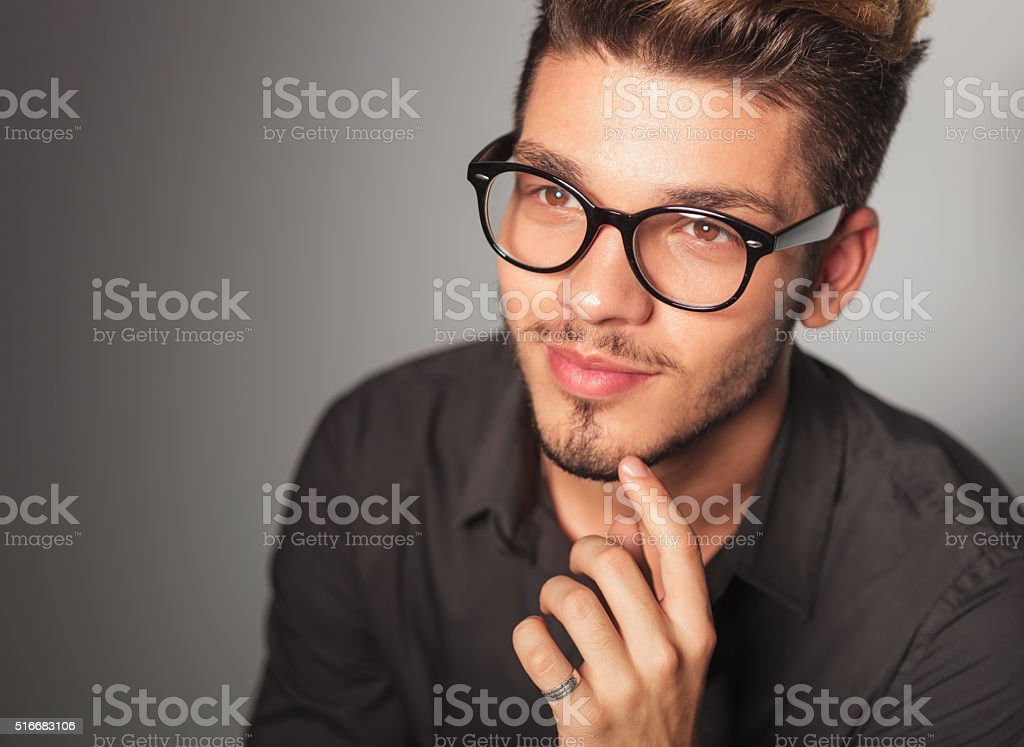 smiling young man dreaming about something stock photo