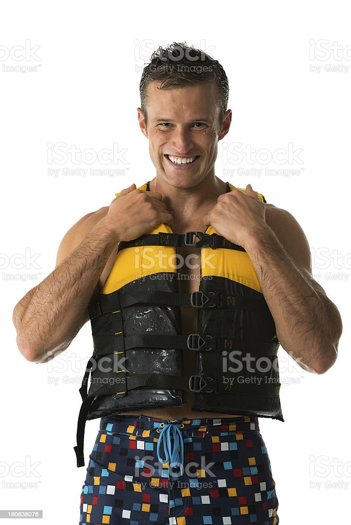 Smiling young man in life jacket royalty-free stock photo