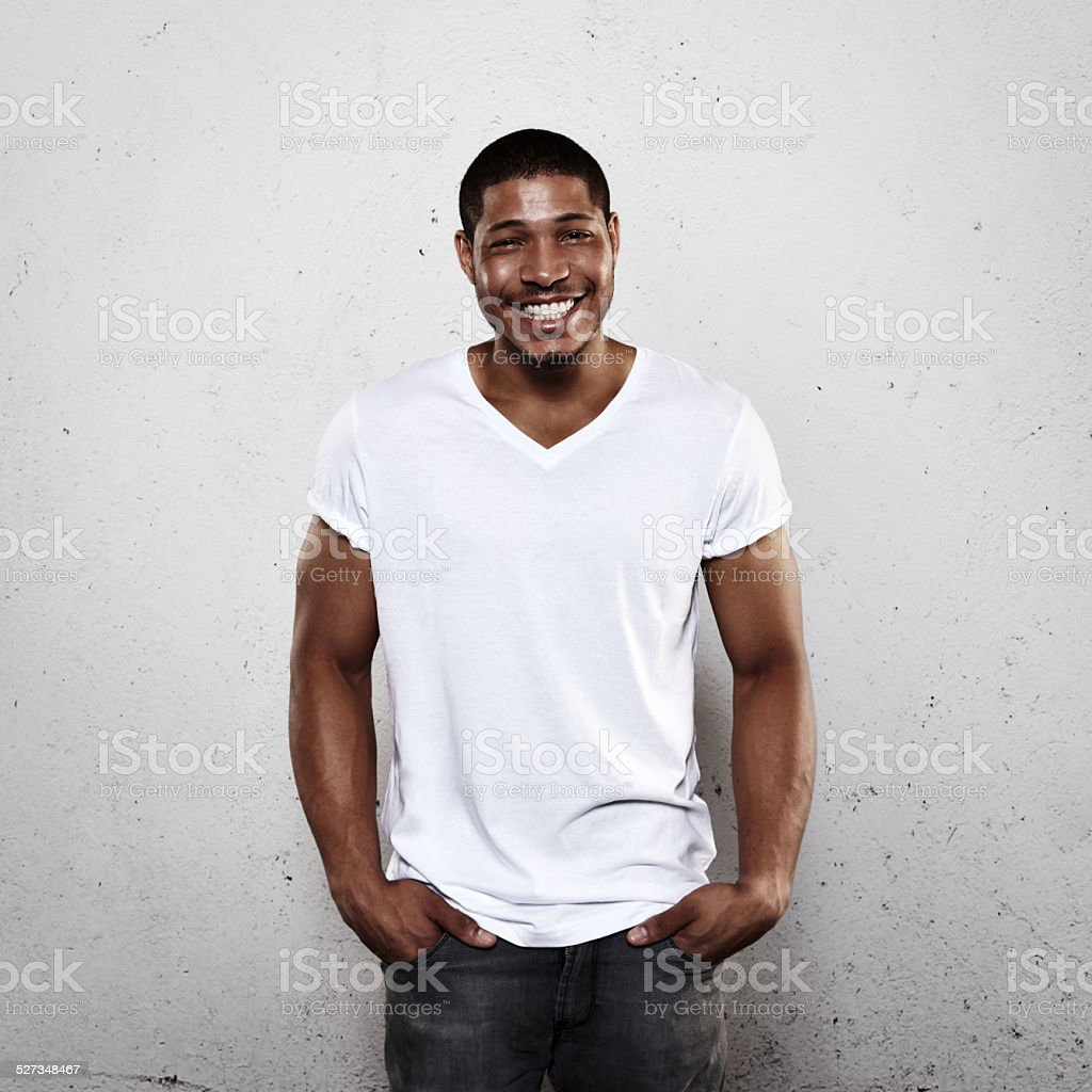Smiling young man in white t-shirt stock photo