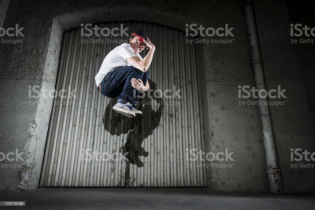 smiling young man jumping royalty-free stock photo