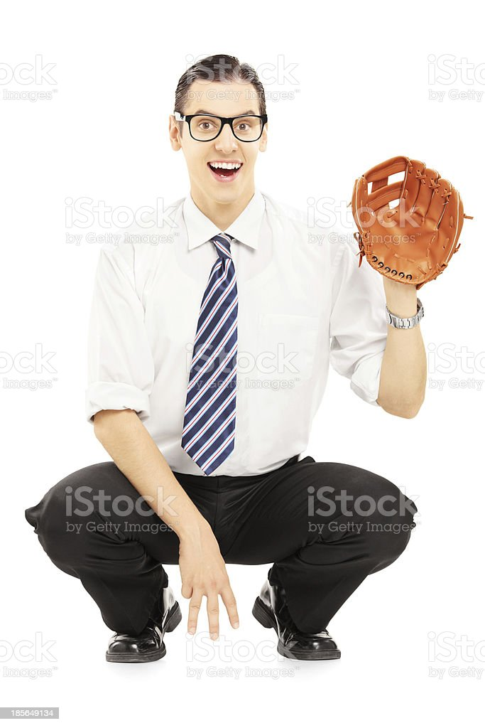 Smiling young man prepared to receive a baseball ball stock photo