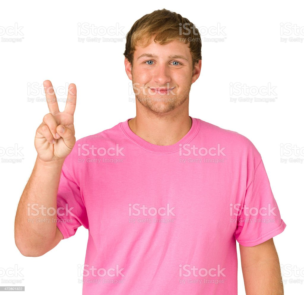 Smiling Young Man Showing Two Fingers stock photo