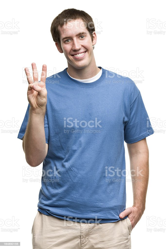 Smiling Young Man Shows Three Fingers stock photo