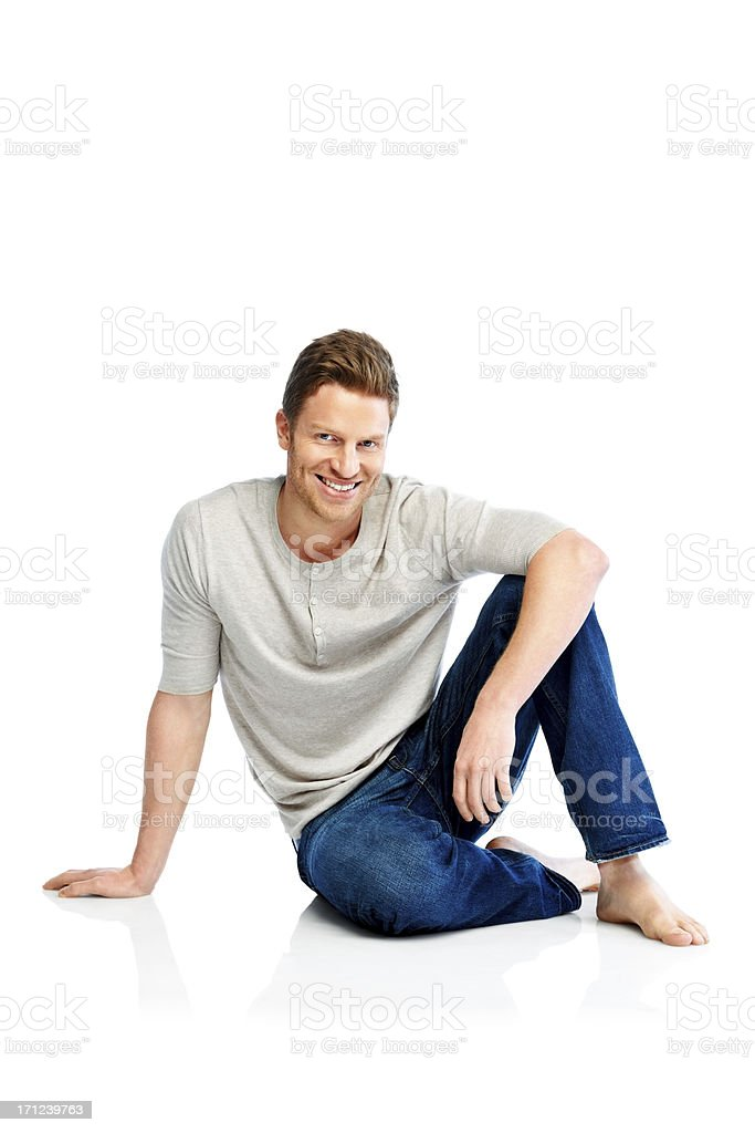 Smiling young man sitting on floor royalty-free stock photo