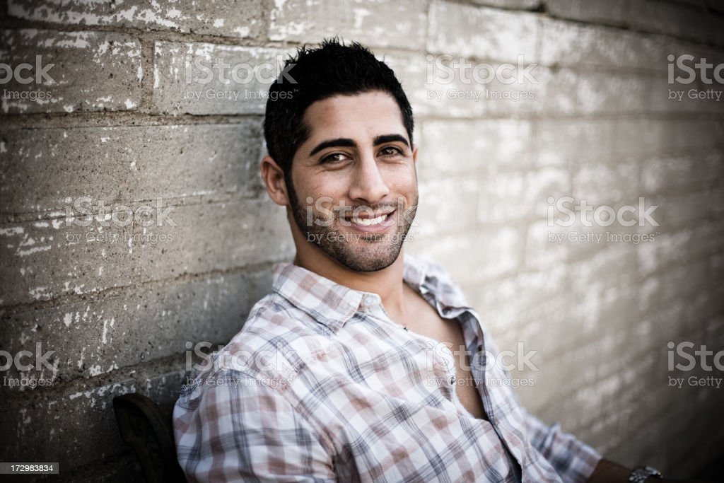 Smiling Young Man Sitting Outside royalty-free stock photo