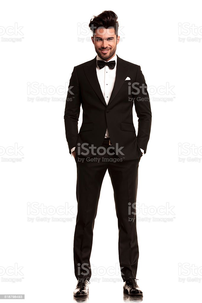smiling young man wearing tuxedo stock photo