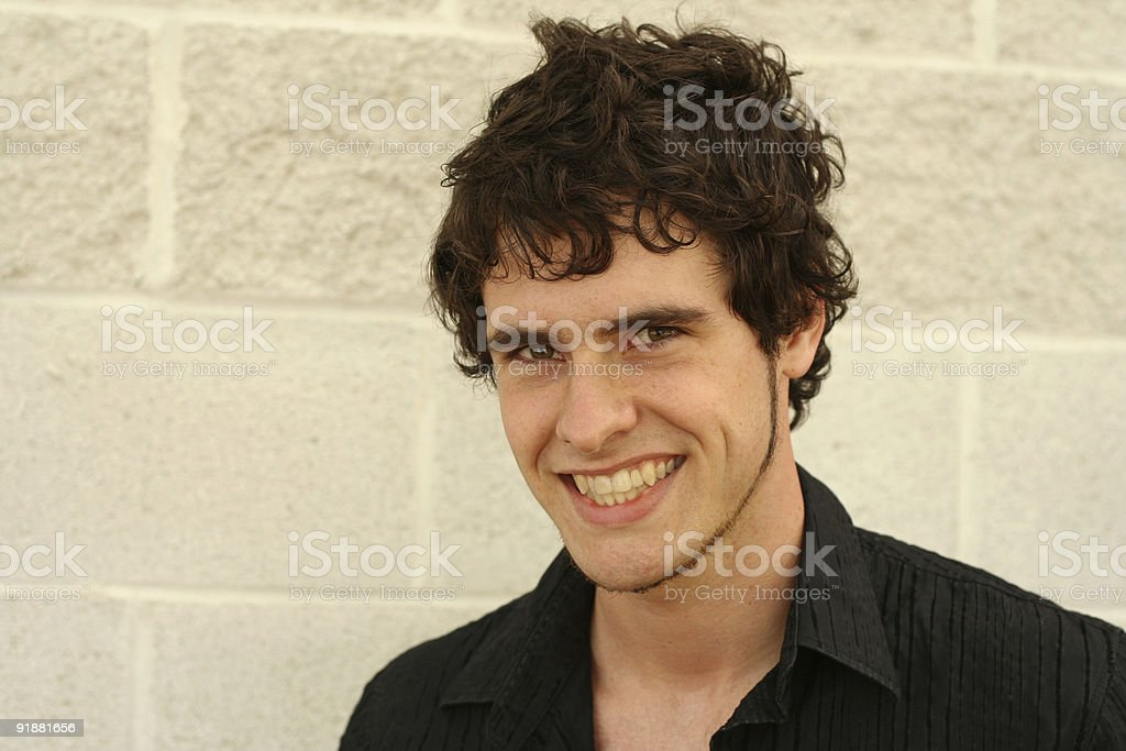 Smiling Young Man with Curly Hair stock photo