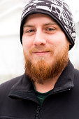 Smiling young man with red beard