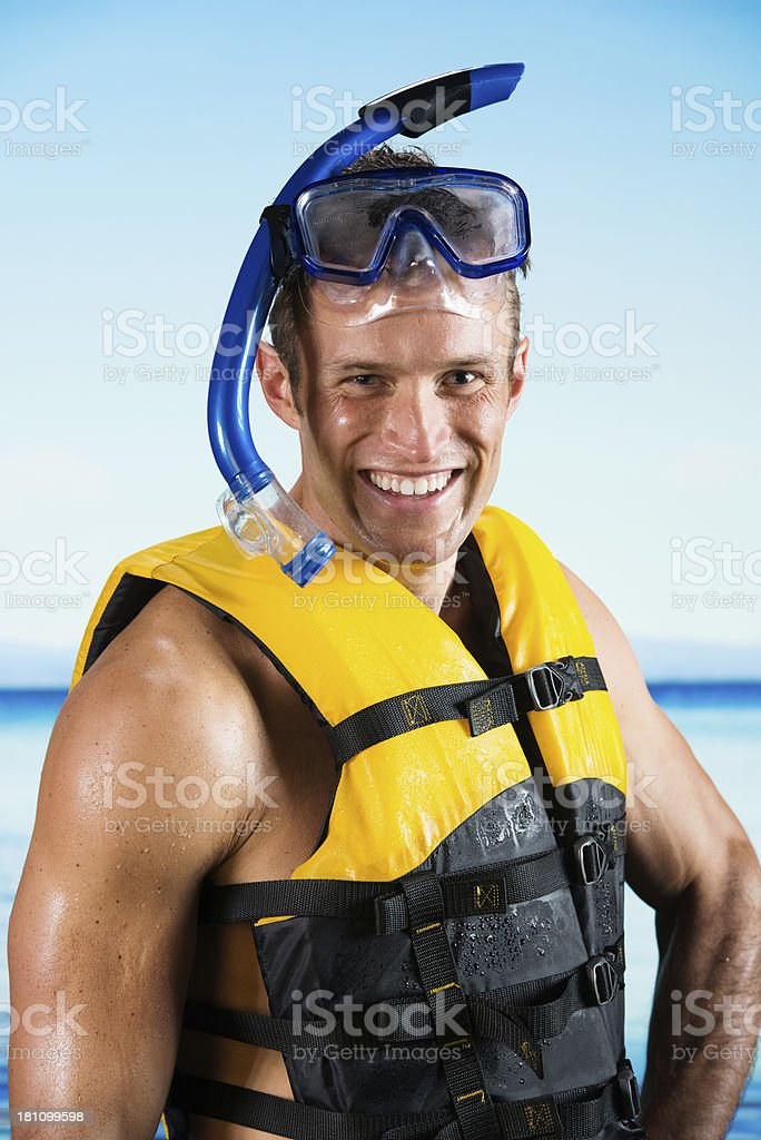 Smiling young man with snorkeling gear royalty-free stock photo