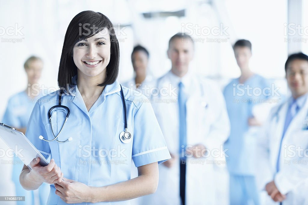Smiling young nurse holding a medical chart royalty-free stock photo