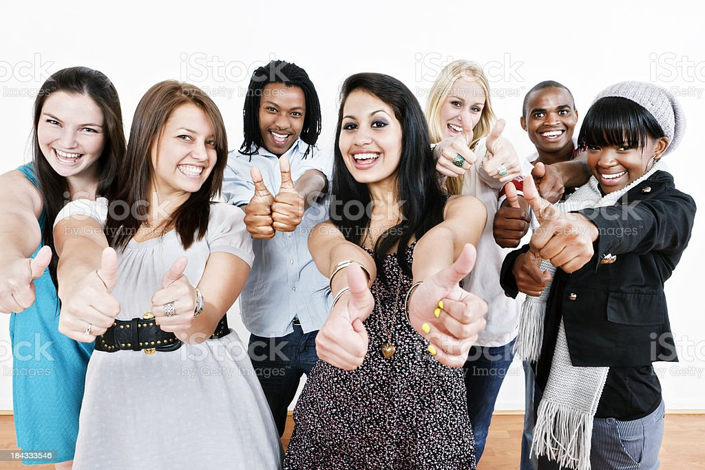 Smiling young people give double thumbs-up of approval royalty-free stock photo