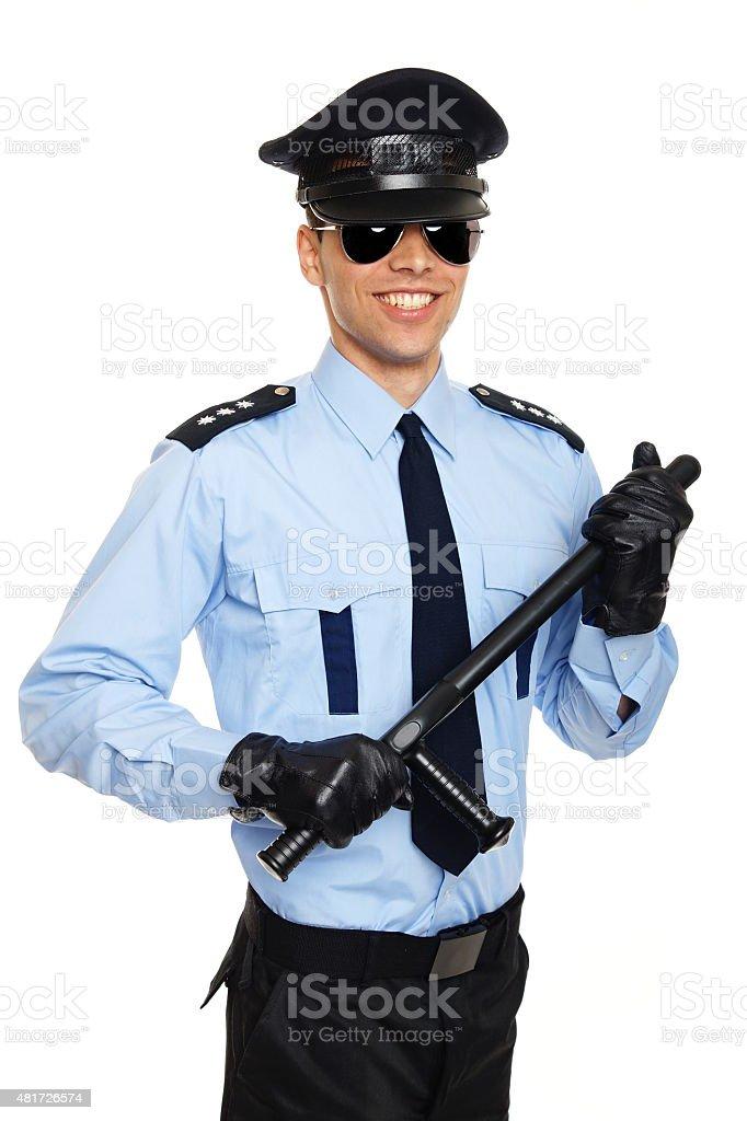 Smiling young policeman stock photo