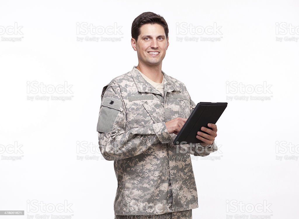 smiling young soldier using a digital tablet royalty-free stock photo