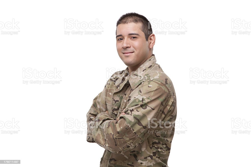 Smiling young soldier with arms crossed royalty-free stock photo