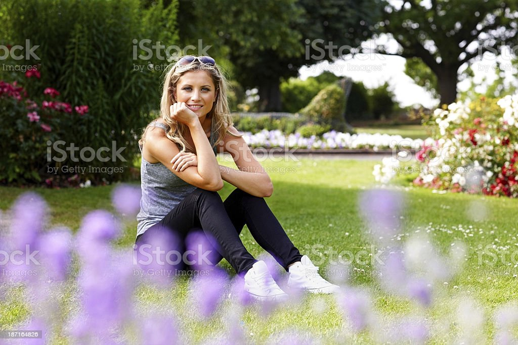 Smiling young woman at the park royalty-free stock photo