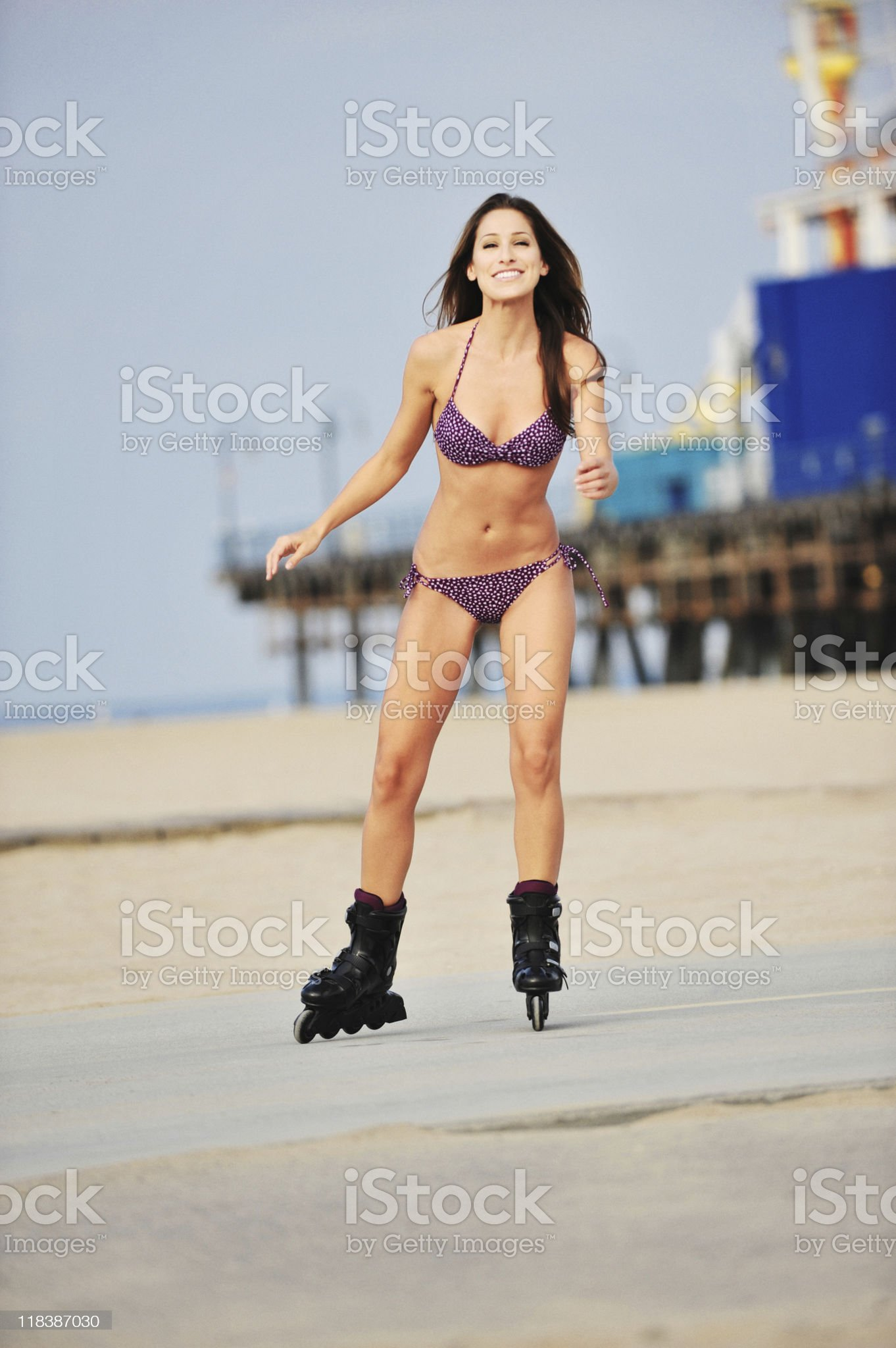 Smiling Young Woman Bikini Model Rollerblading on Santa Monica Beach royalty-free stock photo