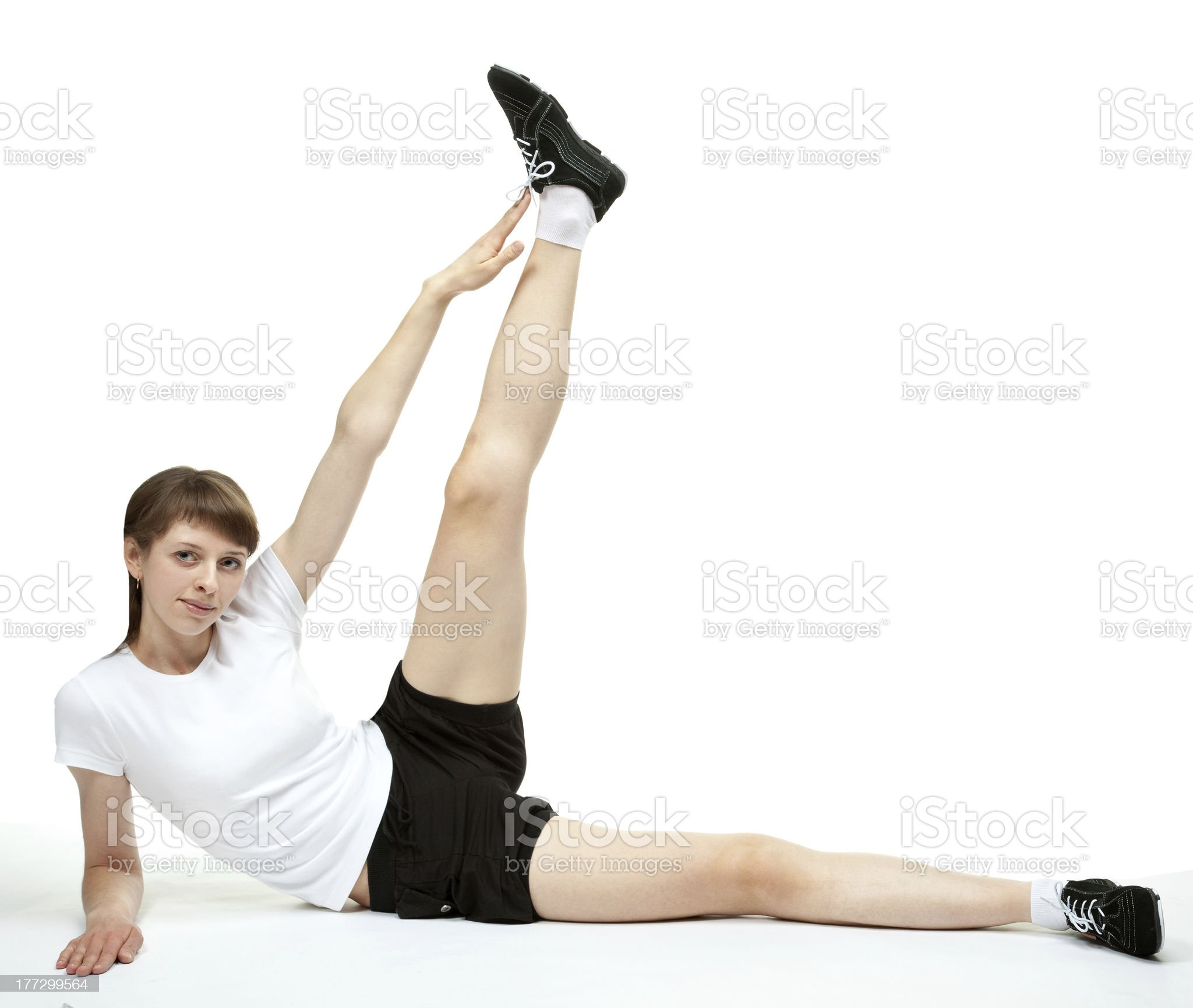 Smiling young woman doing sport exercises royalty-free stock photo
