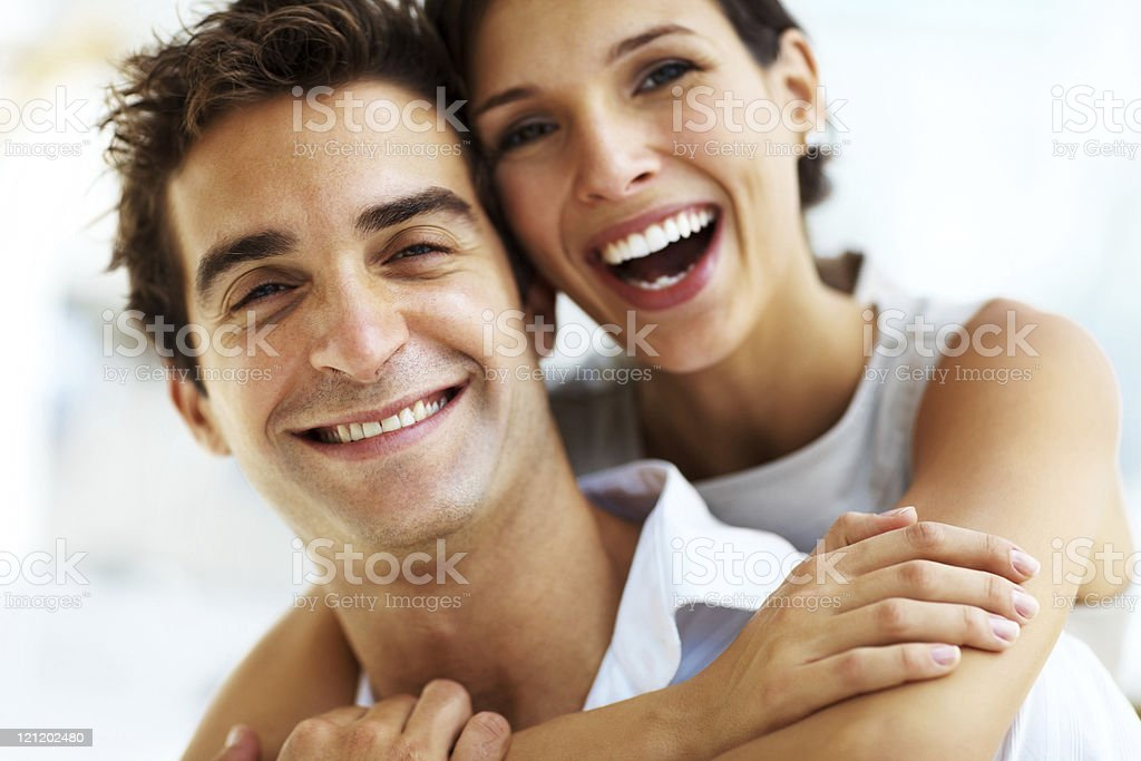 Smiling young woman embracing her handsome boyfriend royalty-free stock photo