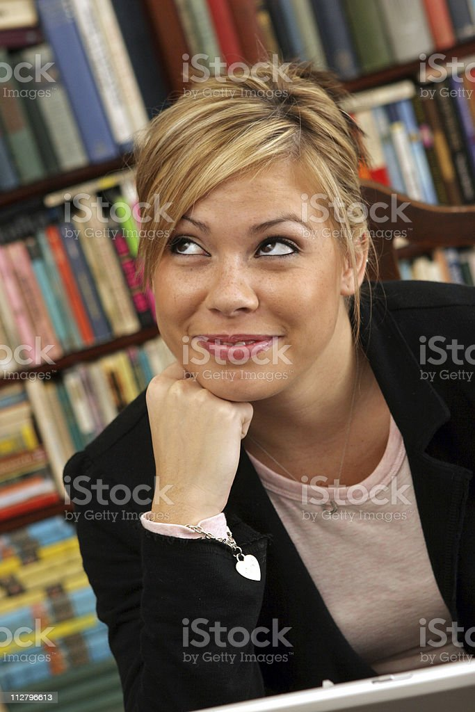 smiling young woman female student in library royalty-free stock photo