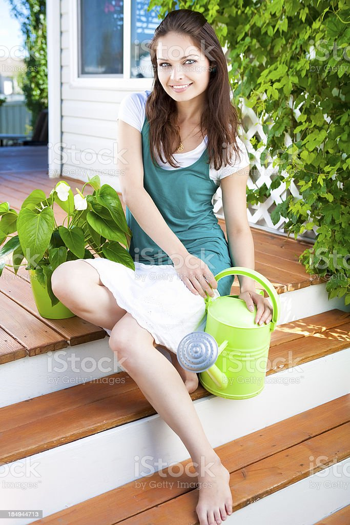 Smiling young woman gardening royalty-free stock photo