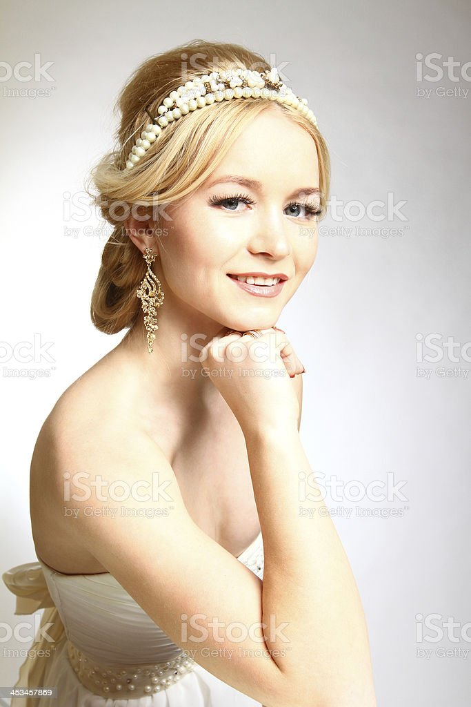 Smiling young woman Greek styled on gray background royalty-free stock photo