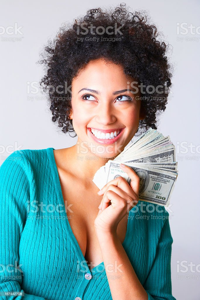 smiling young woman holding dollar bills in her hand royalty-free stock photo