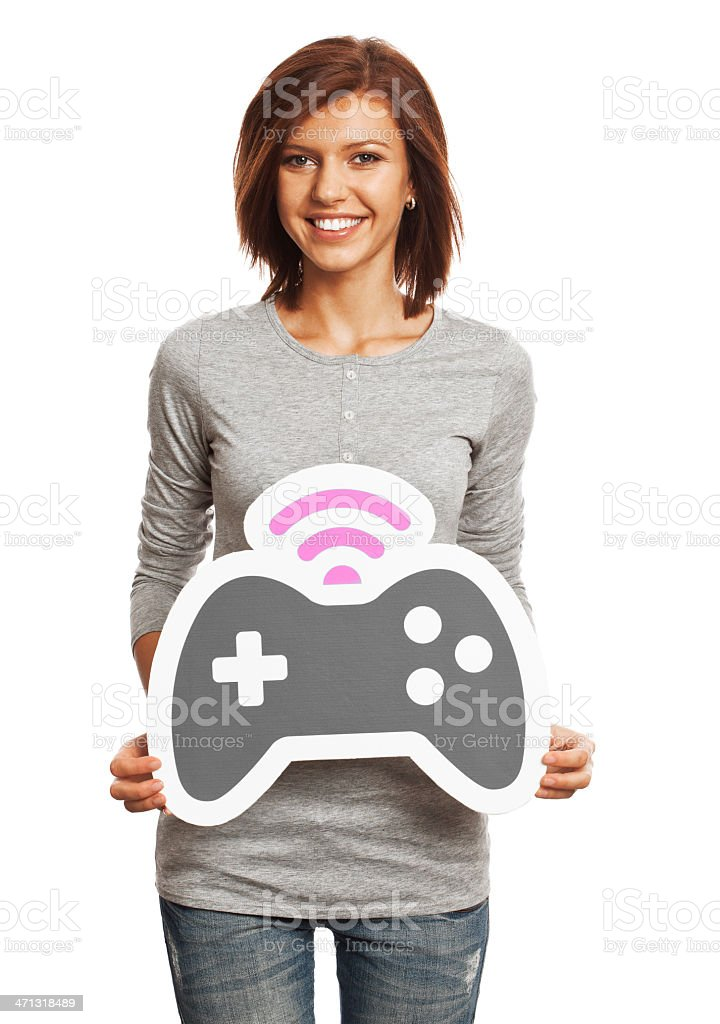 Smiling young woman holding gamepad sign isolated on white background. royalty-free stock photo