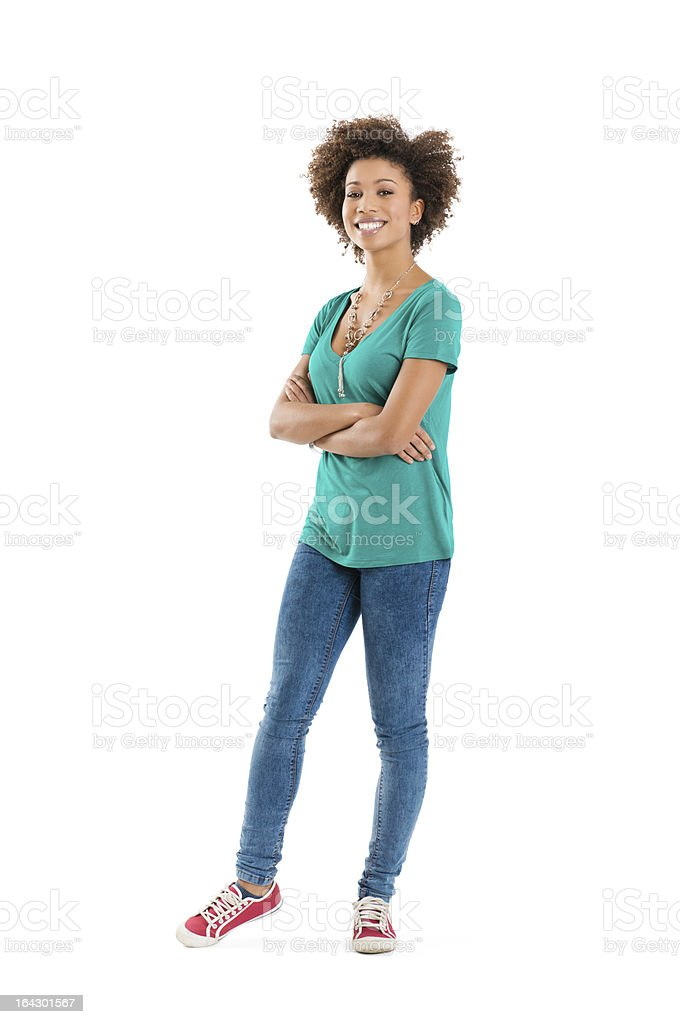 Smiling young woman in green t-shirt and blue jeans stock photo