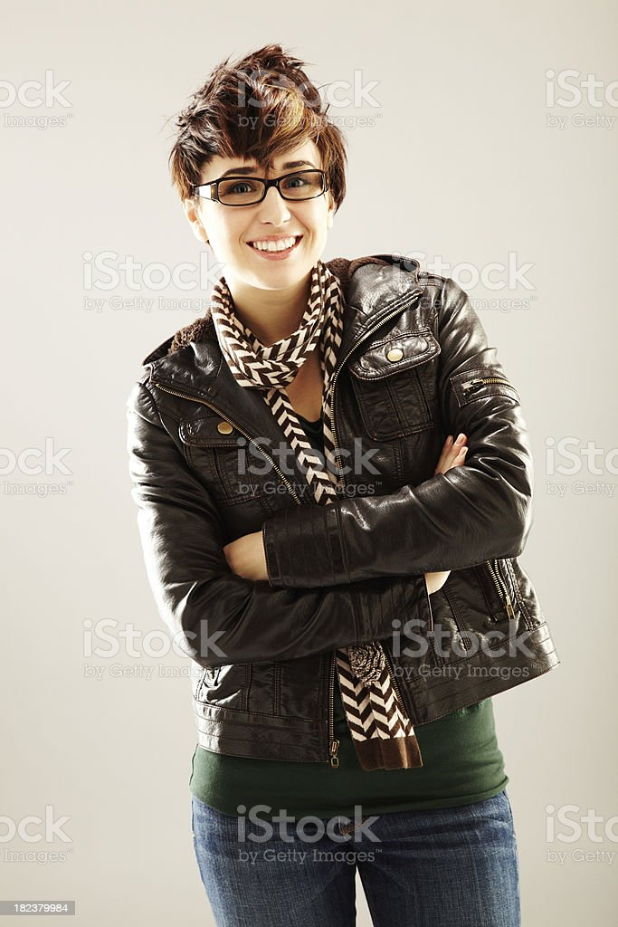 Smiling Young Woman in Leather Jacket royalty-free stock photo
