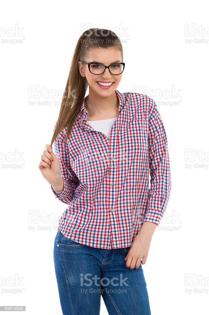 Smiling Young Woman In Lumberjack Shirt stock photo