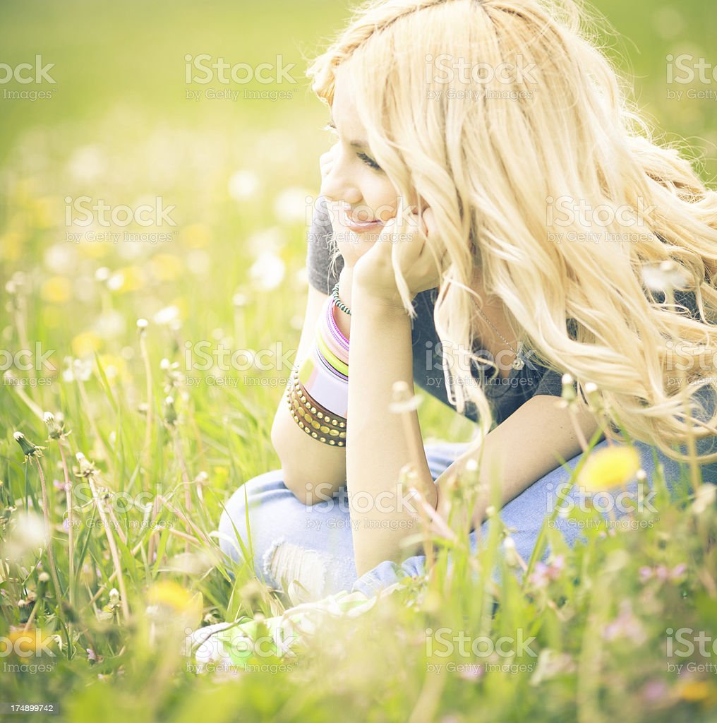 Smiling young woman in meadow royalty-free stock photo