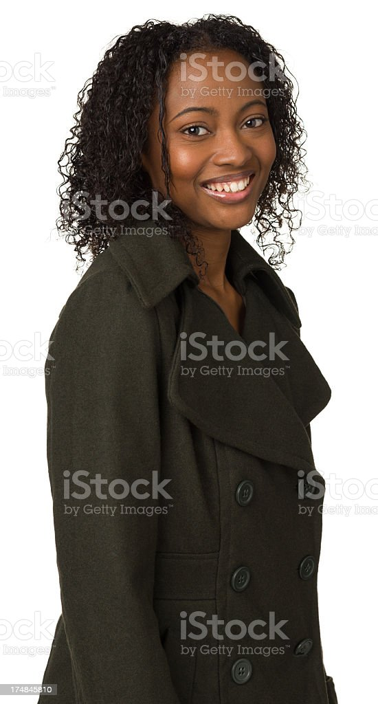 Smiling Young Woman In Olive Green Coat royalty-free stock photo