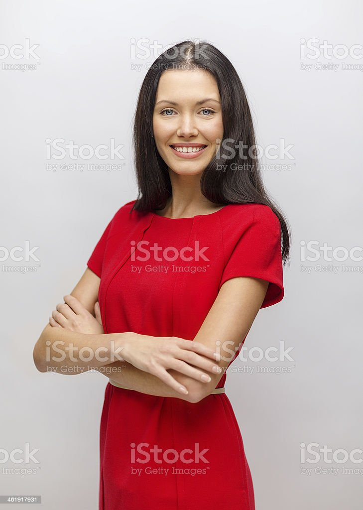 smiling young woman in red dress stock photo