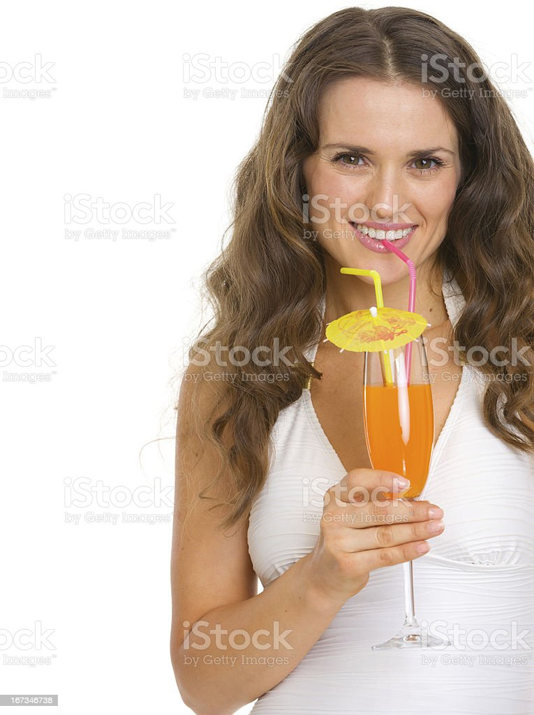 Smiling young woman in swimsuit drinking cocktail royalty-free stock photo