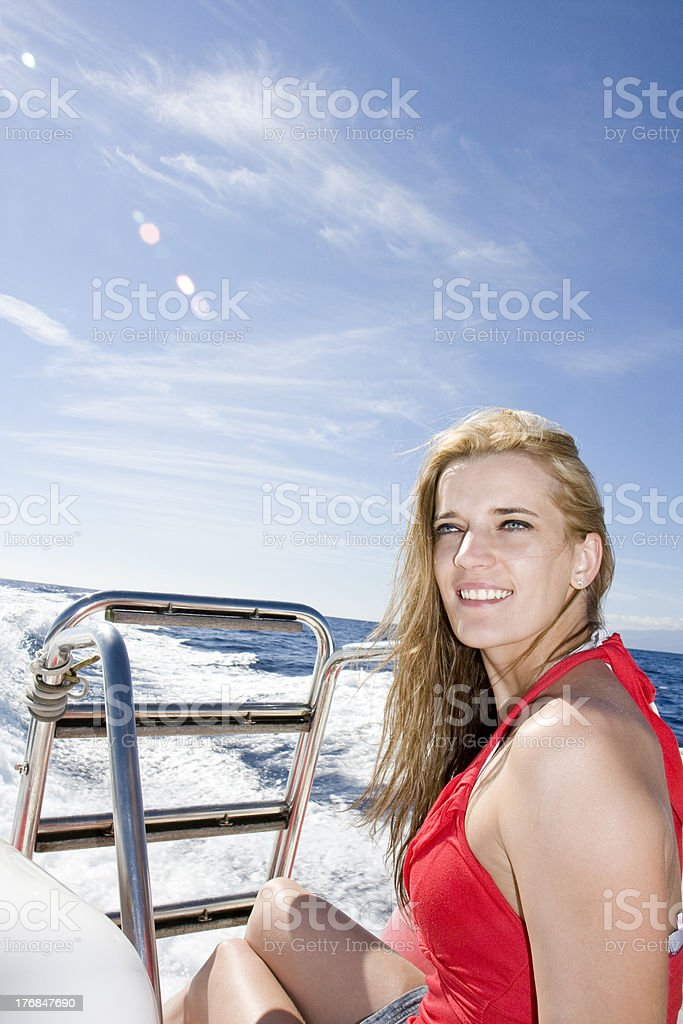 Smiling young woman in yach stock photo