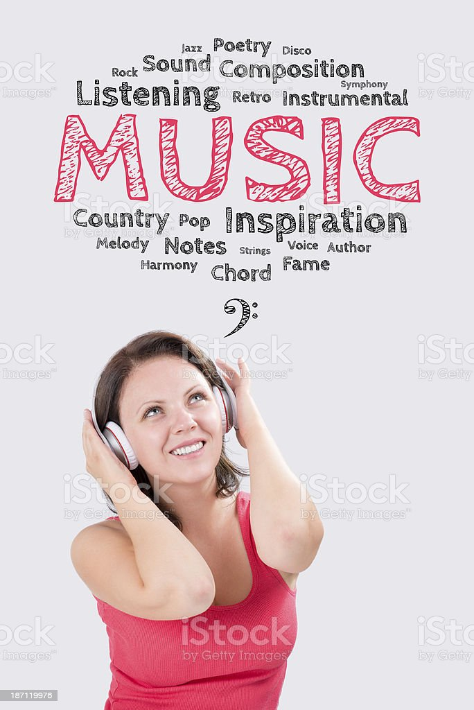 Smiling young woman is listening to music under  emotions bubble stock photo
