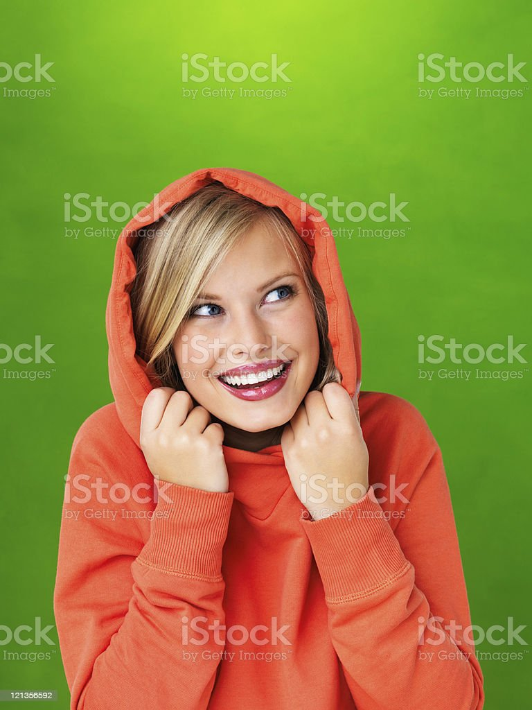 Smiling, young woman looking up royalty-free stock photo