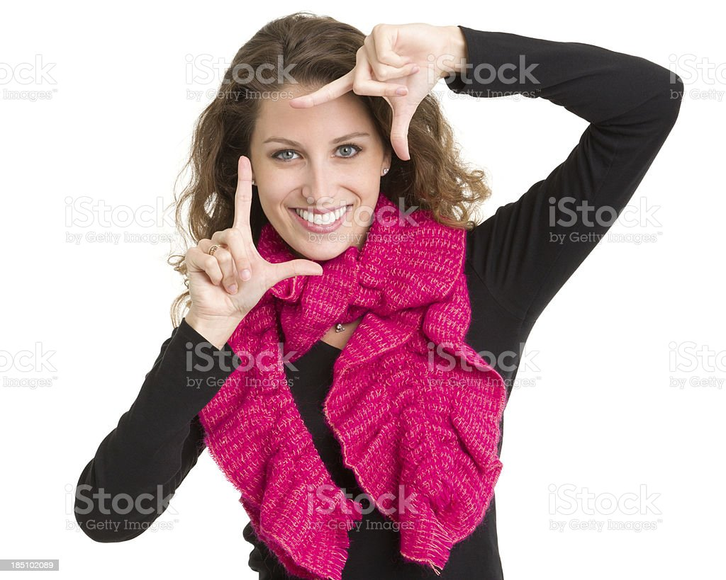 Smiling Young Woman Makes Finger Frame royalty-free stock photo
