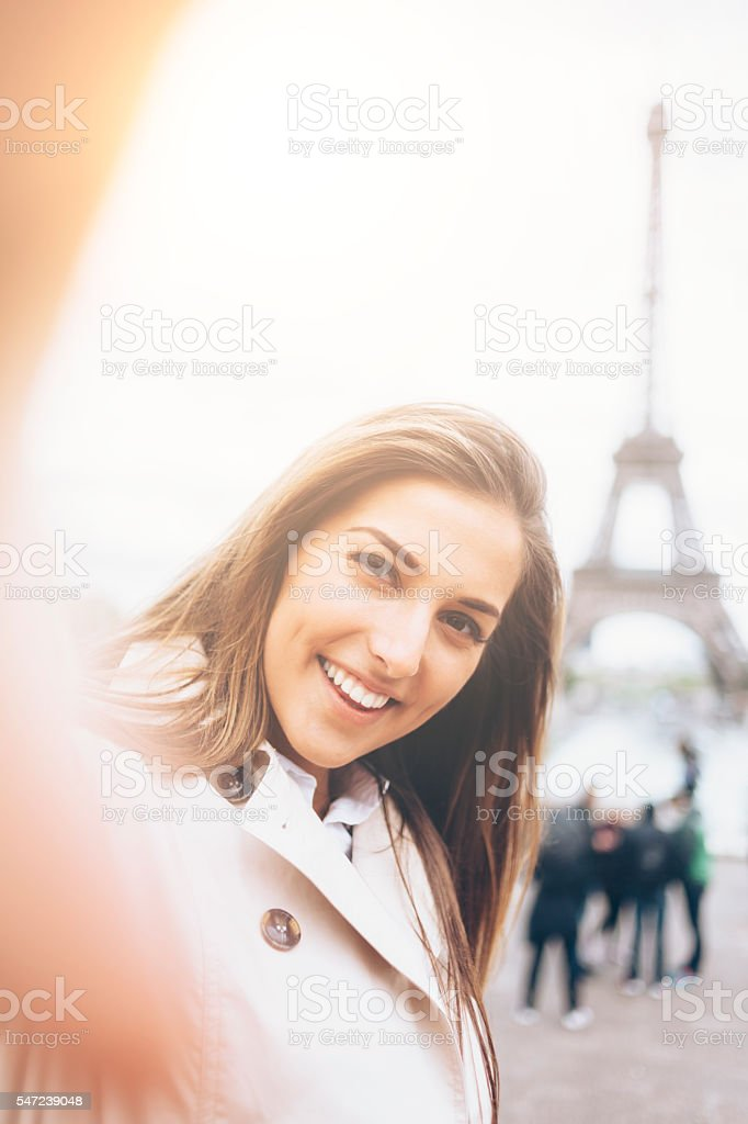 Smiling young woman making selfie stock photo