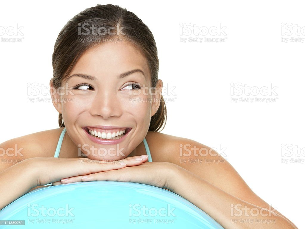 Smiling young woman on an exercise ball royalty-free stock photo