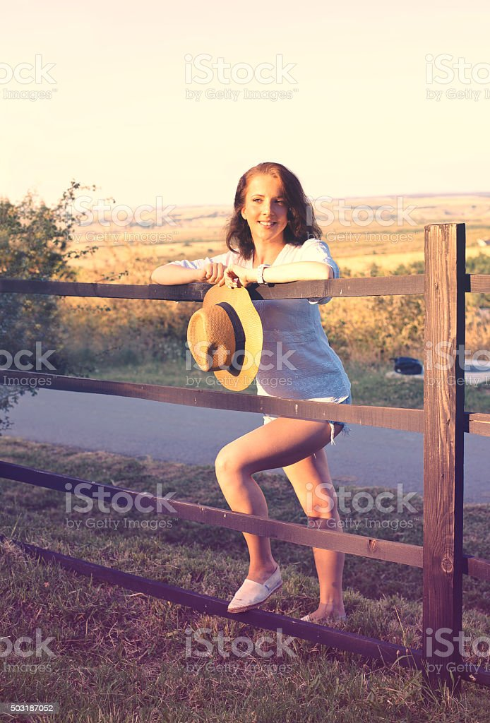 Smiling young woman outdoors stock photo
