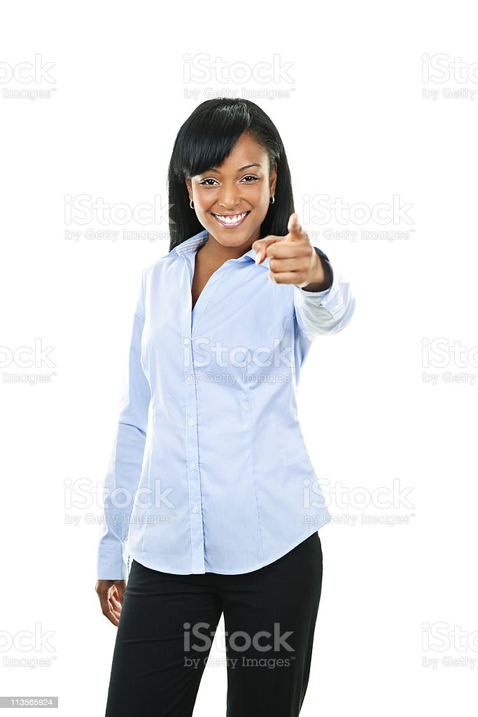 Smiling young woman pointing finger stock photo